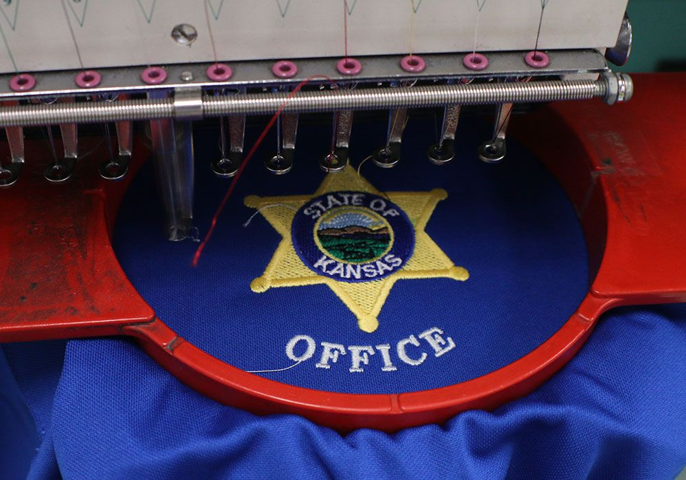 Embroidered police badges