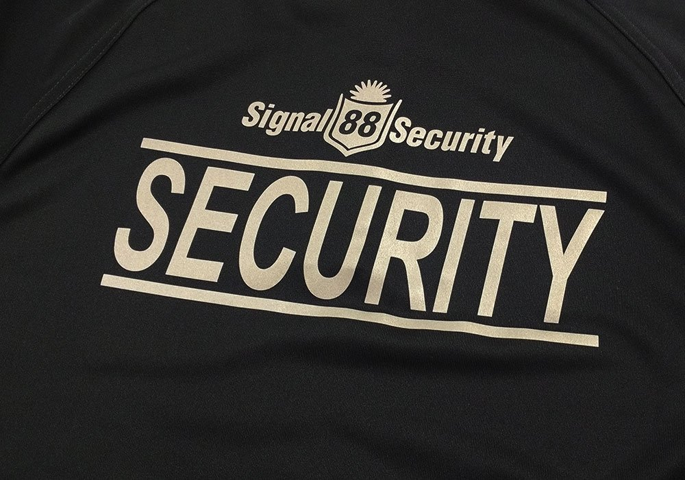 Heat Press logo on security uniform for Signal 88 Security