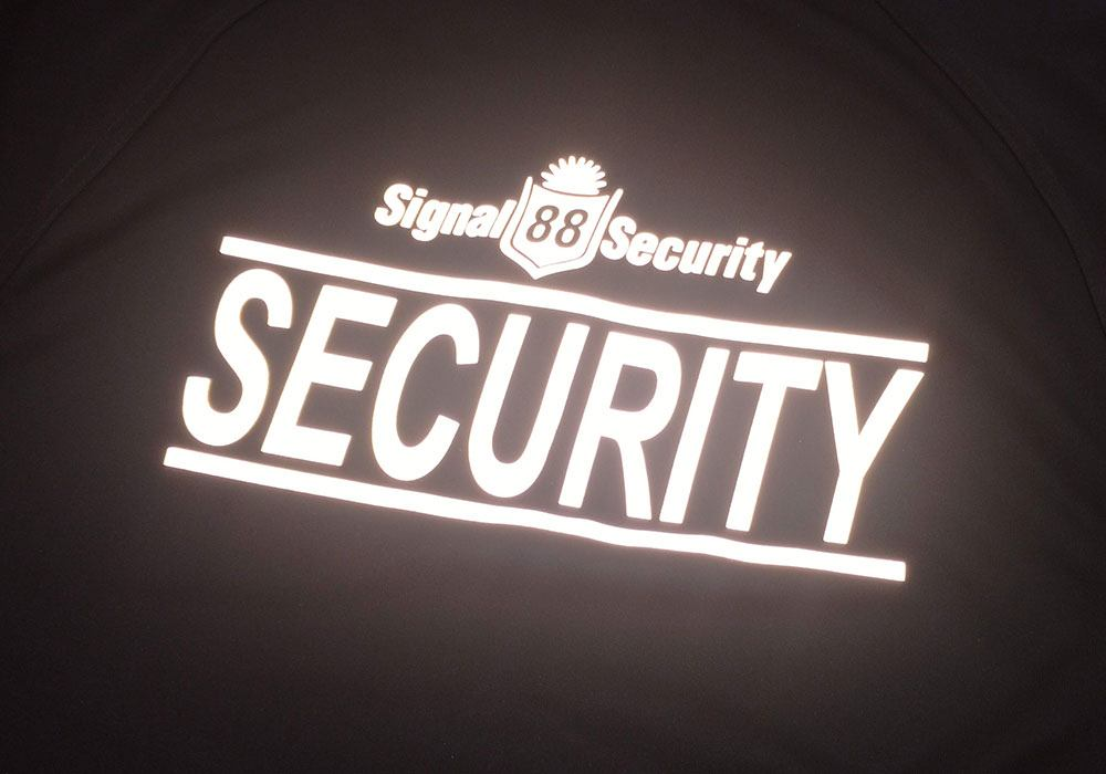 Reflective Heat Press logo on security uniform for Signal 88 Security