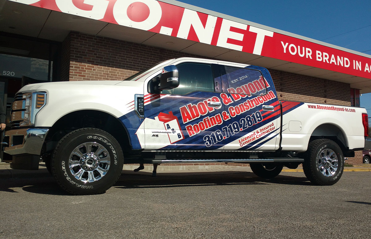 Above and Beyond Roofing and Construction partial truck wrap