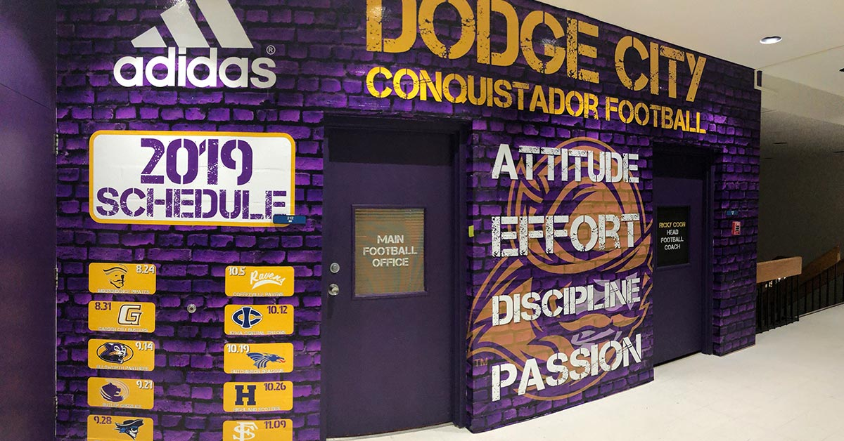 Impress Your Fans with Interior Graphics like these that were made for Dodge City Community College's Adidas Sponsored Conquistador Football Team's 2019 Schedule Wall Graphics