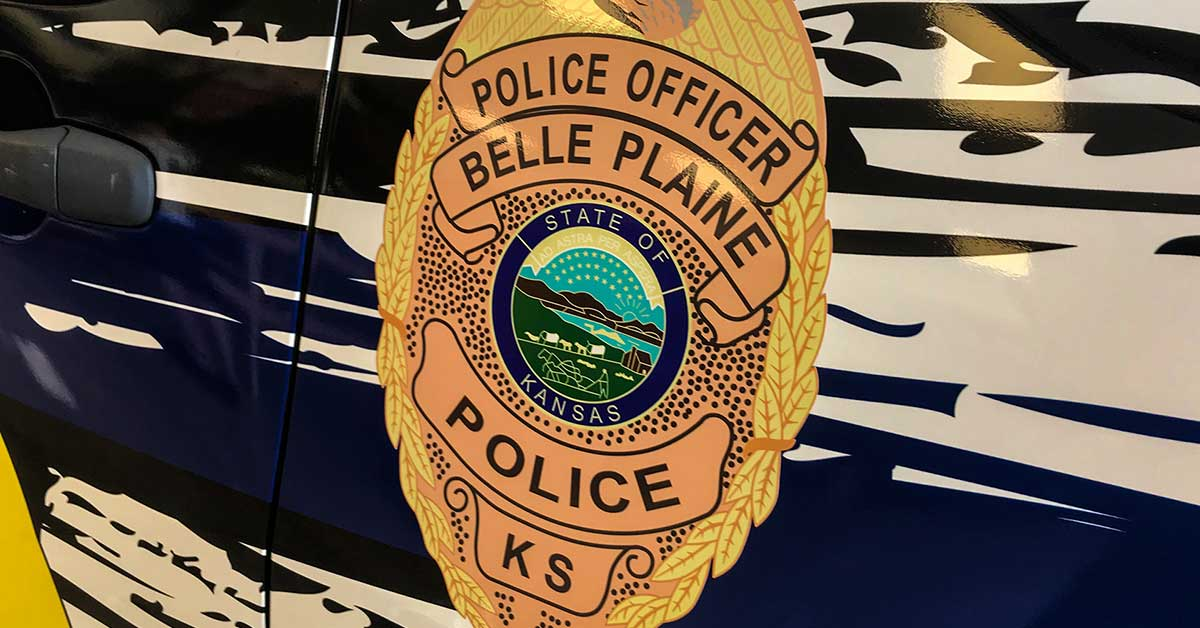 The Ins and Outs of Police and Security Vehicle Graphics - Badge emblem on the side of a police car from Belle Plaine, Kansas