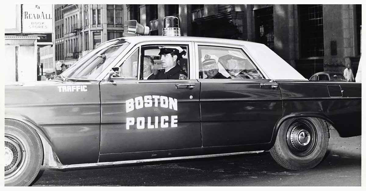 The Ins and Outs of Police and Security Vehicle Graphics - Vintage, black and white photo of old Boston police car