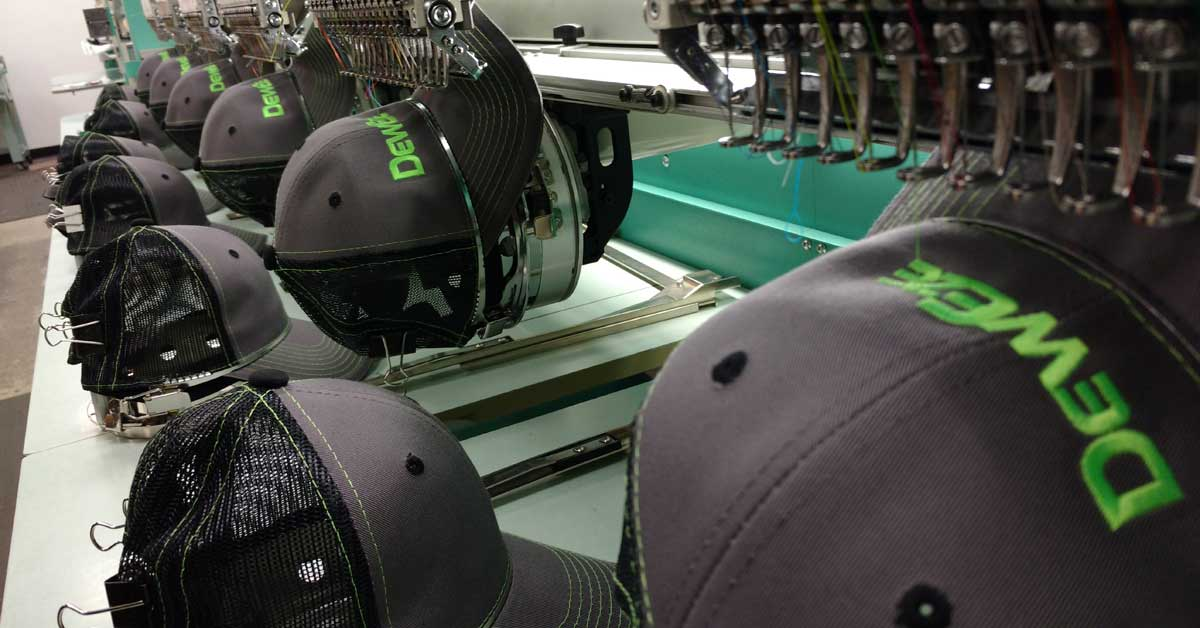 DEWEze Embroidered Caps - Embroidering multiple caps at once on Tajima Embroidery Machine