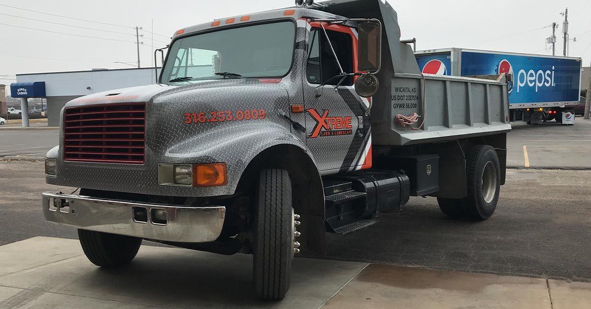 Marketing Your Business with Vinyl Wraps for Semi-Trucks - Xtreme Landscape's Semi Dump Truck Wrap