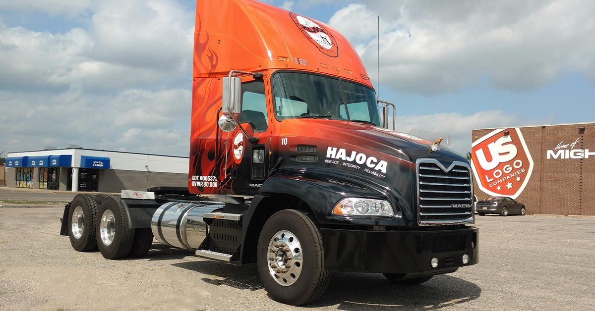 Marketing Your Business with Vinyl Wraps for Semi-Trucks -Check out Hajoca's beautiful burnt orange and black flame designed semi truck wrap